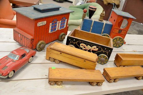Group of toys to include painted ride-on wood train (ht. 12in., lg. 18in.), small wood train, etc.   Provenance: The Estate o