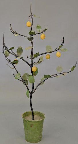 Metal lemon tree (several lemons missing). ht. 64 in.  Provenance: From the Estate of Faith K. Tiberio of Sherborn, Massachus