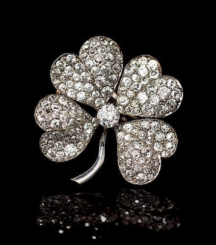 An Edwardian Platinum and Diamond Four Leaf Clover Pendant/Brooch, 5.00 dwts.