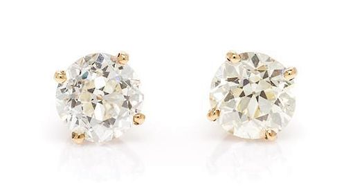 A Pair of 14 Karat Yellow Gold and Diamond Stud Earrings, 1.10 dwts.