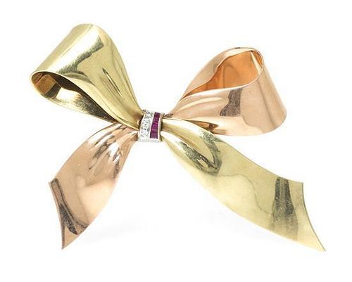 A Retro Gold, Platinum, Ruby and Diamond Bow Brooch, 19.60 dwts.