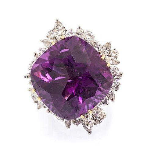 An 18 Karat Gold, Amethyst and Diamond Ring, 13.00 dwts.