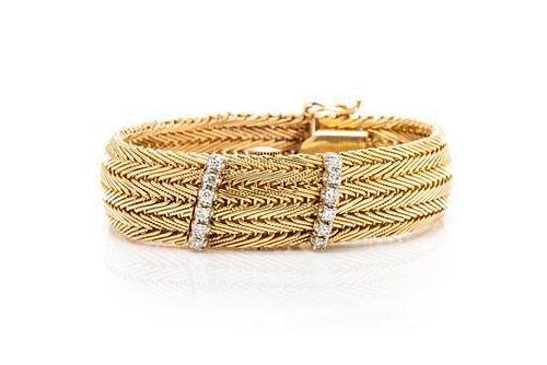 A 14 Karat Yellow Gold and Diamond Surprise Wristwatch, Emewo, 23.50 dwts.