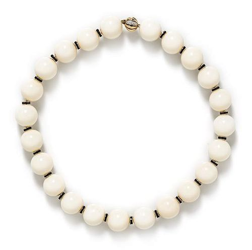 An 18 Karat Yellow Gold and White Hardstone Bead Necklace,