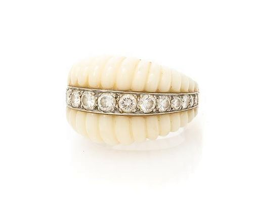 An 18 Karat Yellow Gold, White Coral and Diamond Ring, 9.26 dwts.