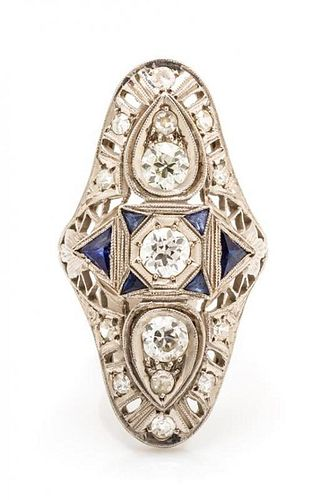 An Art Deco Platinum, Diamond and Synthetic Sapphire Ring, 3.90 dwts.