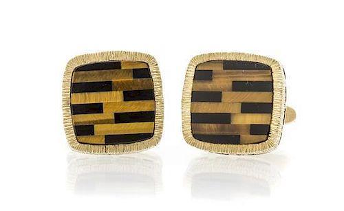 A Pair of 14 Karat Yellow Gold, Onyx and Tigers Eye Quartz Cufflinks, La Triomphe, 10.50 dwts.