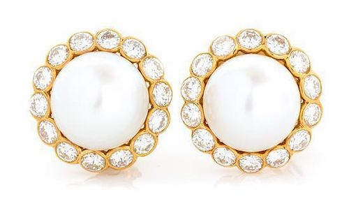 A Pair of 18 Karat Yellow Gold, Cultured South Sea Pearl and Diamond Earclips, Van Cleef & Arpels, 17.10 dwts.