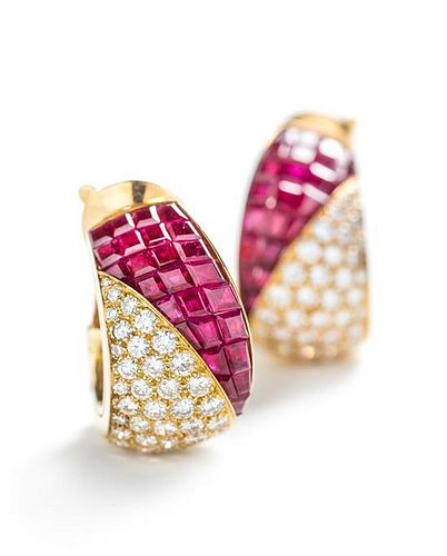 A Pair of 18 Karat Yellow Gold, Diamond and Invisible Set Ruby Earclips, Van Cleef & Arpels, 16.00 dwts.