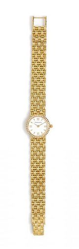 An 18 Karat Yellow Gold and Diamond Wristwatch, Tiffany & Co., 30.40 dwts.