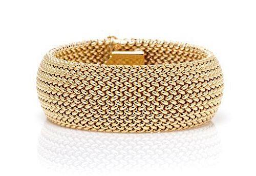 A 14 Karat Yellow Gold and Diamond Bracelet, 48.40 dwts.