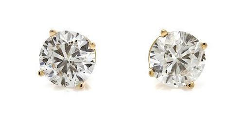 A Pair of 14 Karat Yellow Gold and Diamond Stud Earrings, 0.70 dwts.