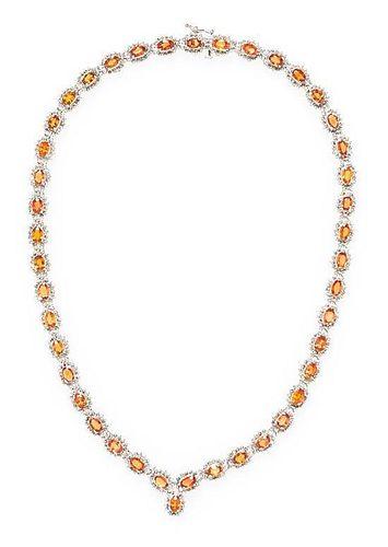 A 14 Karat White Gold, Orange Sapphire and Diamond Necklace, 25.50 dwts.