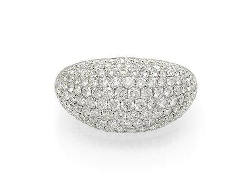 An 18 Karat White Gold and Diamond Bombe Ring, 5.40 dwts.