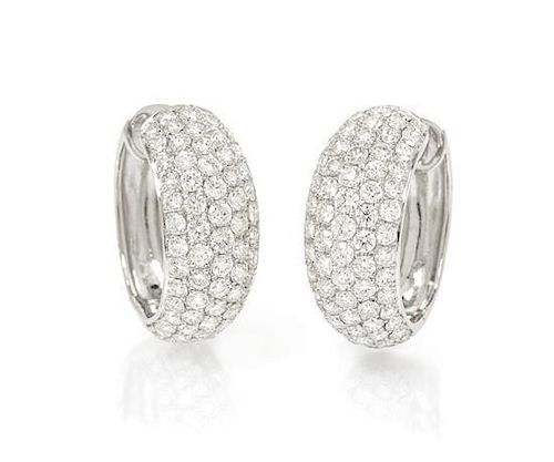 A Pair of 18 Karat White Gold and Diamond Hoop Earrings, 4.80 dwts.