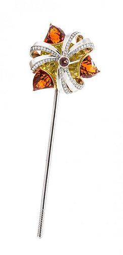An 18 Karat Gold, Diamond and Multi Gem Articulated Pinwheel Brooch, Michael Youssoufian, 27.70 dwts.