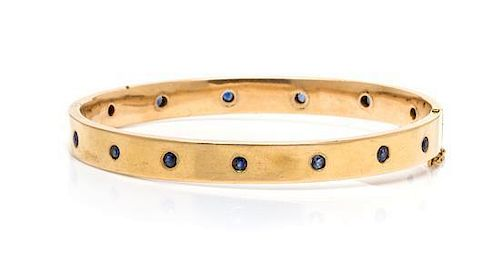 A 14 Karat Yellow Gold and Sapphire Bangle Bracelet, 9.10 dwts.