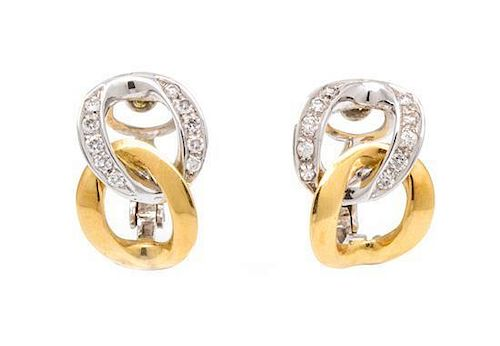 A Pair of 18 Karat Gold and Diamond Earclips, 5.60 dwts.