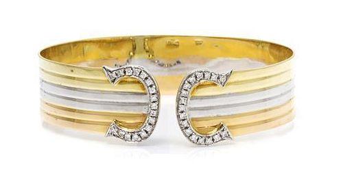 An 18 Karat Tricolor Gold and Diamond Bangle Bracelet, 16.50 dwts.