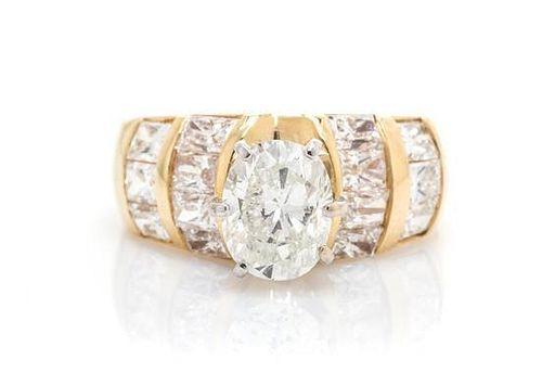 A 14 Karat Yellow Gold and Diamond Ring, 4.10 dwts.