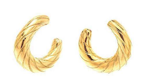 A Pair of 14 Karat Yellow Gold Textured Hollowform Hoop Earclips, 18.25 dwts.