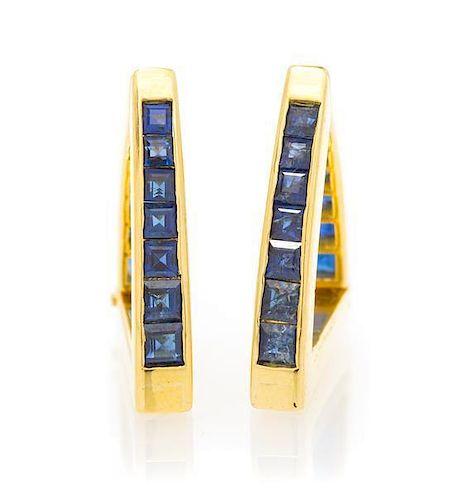 A Pair of 18 Karat Yellow Gold and Sapphire Cufflinks, 9.60 dwts.