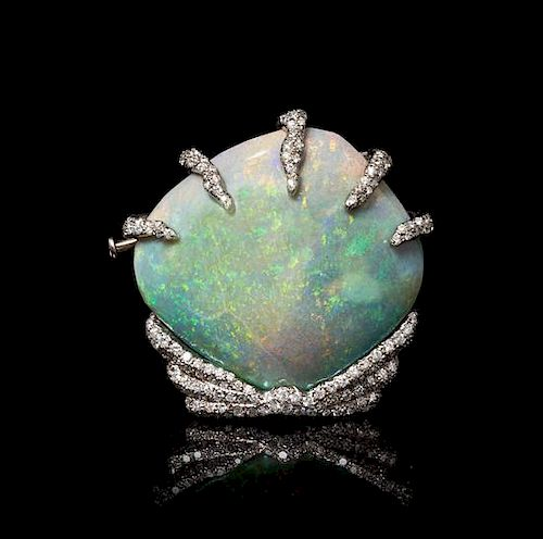 An 18 Karat White Gold, Opalized Clam Shell and Diamond Brooch, 14.90 dwts.