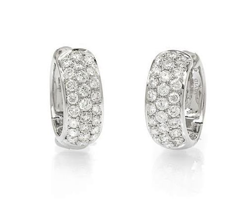 A Pair of 18 Karat White Gold and Diamond Hoop Earrings, 3.40 dwts.