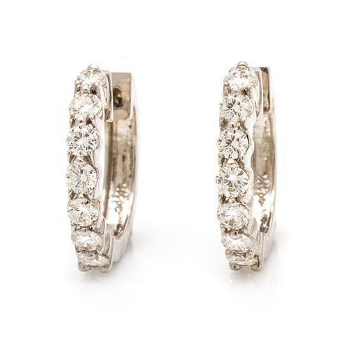 A Pair of 14 Karat White Gold and Diamond Hoop Earrings, 3.20 dwts.