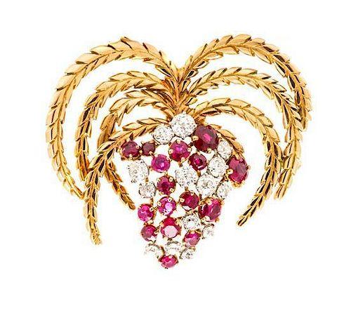 An 18 Karat Rose Gold, Platinum, Ruby and Diamond Brooch, Circa 1920, 10.35 dwts.