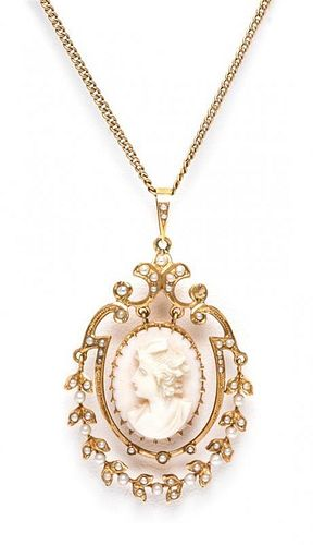 A Victorian Yellow Gold, Seed Pearl and Coral Cameo Pendant, 5.20 dwts.
