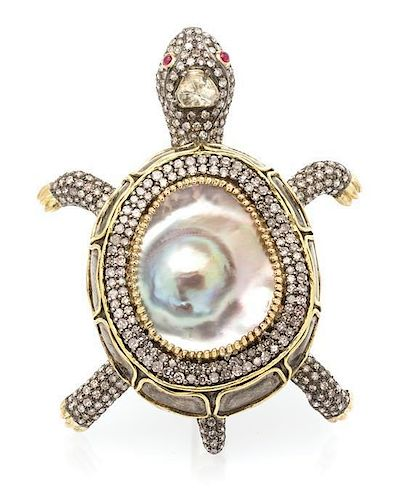 * A 10 Karat Yellow Gold, Diamond, Mabe Pearl and Ruby Tortoise Brooch, 18.00 dwts.