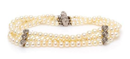 * A White Gold, Diamond and Cultured Pearl Multi Strand Bracelet, 8.90 dwts.