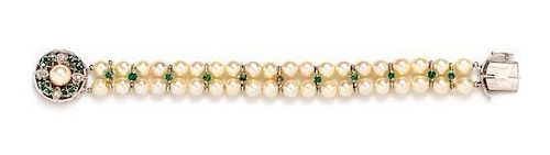 A White Gold, Diamond, Emerald and Cultured Pearl Bracelet, 14.50 dwts.
