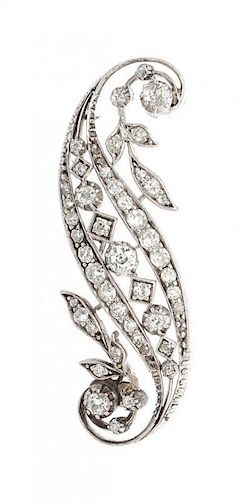 A White Gold and Diamond Swirl Brooch, 8.00 dwts.