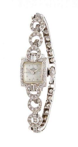 * A 14 Karat White Gold and Diamond Wristwatch, Hamilton, 10.70 dwts.