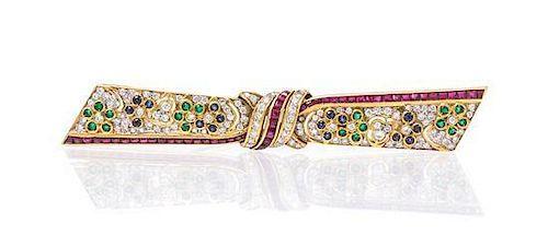 * An 18 Karat Gold, Diamond, Ruby, Sapphire and Emerald Bar Brooch, 9.70 dwts.