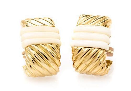 * A Pair of 18 Karat Yellow Gold and White Coral Earclips, 23.10 dwts.