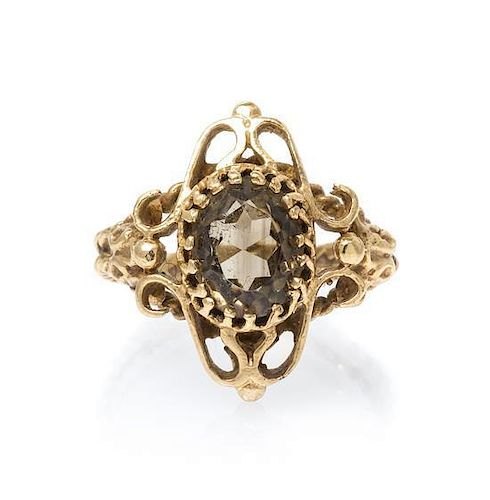 A 14 Karat Yellow Gold and Smokey Quartz Ring, 4.40 dwts.
