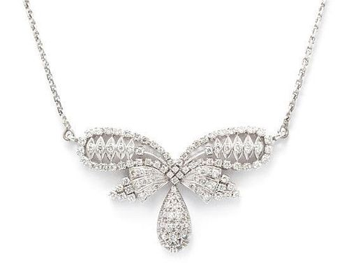 A White Gold and Diamond Bow Motif Necklace, 13.30 dwts.
