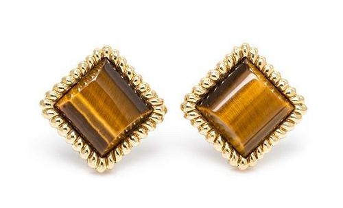 A Pair of 14 Karat Yellow Gold and Tiger's Eye Quartz Earclips, 15.30 dwts.
