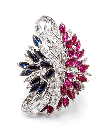 An 18 Karat White Gold, Diamond, Ruby and Sapphire Ring, 17.20 dwts.