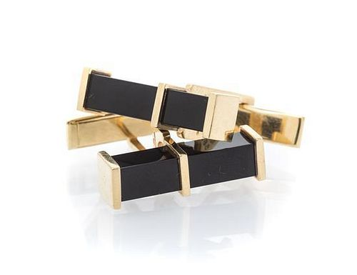 A Pair of 14 Karat Yellow Gold and Onyx Cufflinks, 6.70 dwts.