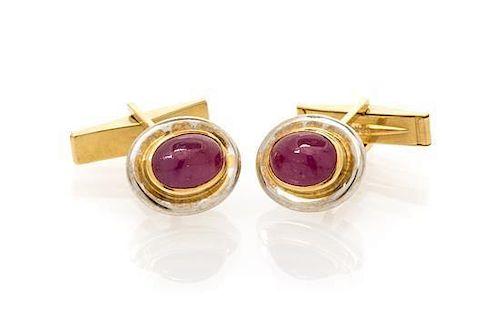 A Pair of 18 Karat Gold and Ruby Cufflinks, 7.20 dwts.