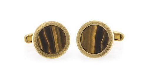 A Pair of 14 Karat Yellow Gold and Tigers Eye Cufflinks, 16.30 dwts.
