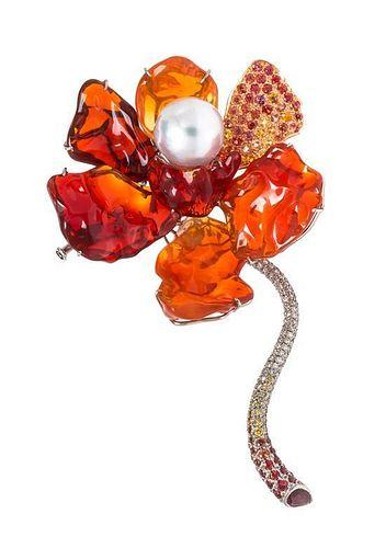 * An 18 Karat Gold, Fire Opal, Cultured Pearl, Sapphire and Diamond Flower Brooch, 23.80 dwts.