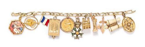 * A Yellow Gold and Goldtone Charm Bracelet with 11 Attached Charms, 33.80 dwts.