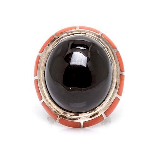 A Sterling Silver, Onyx and Coral Ring, Erte, 15.80 dwts.
