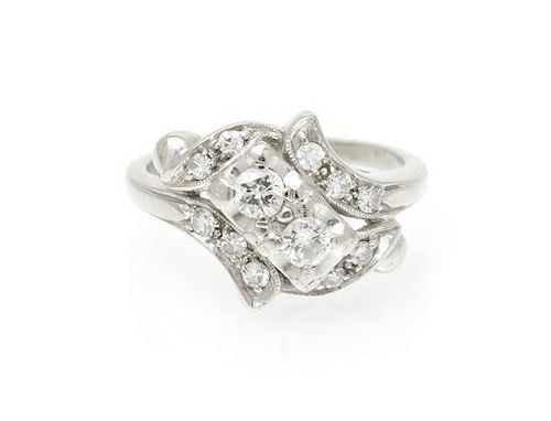 A 14 Karat White Gold and Diamond Ring, 2.90 dwts.
