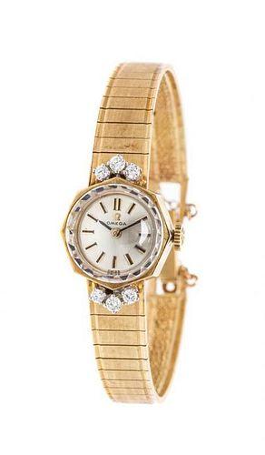 A 14 Karat Yellow Gold and Diamond Wristwatch, Omega, 14.30 dwts.